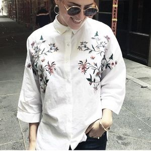 White blouse with embroidered flowers